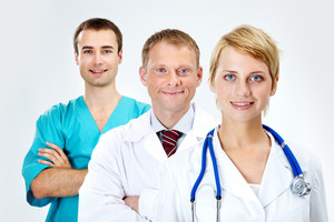 Portrait of friendly doctors looking at camera with smiles