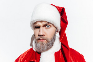 Portrait of funny amazed santa claus over white background