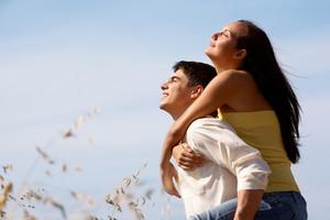 Portrait of girlfriend and boyfriend enjoying summer day outdoors