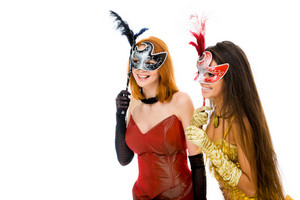 Portrait of glamorous girls looking through venetian masks during carnival