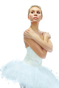 Portrait of graceful ballerina posing on white background