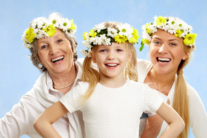 Portrait of grandmother and mother behind smiling girl