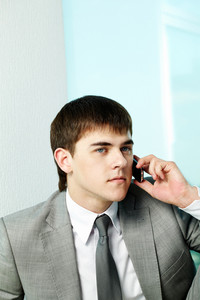 Portrait of handsome man calling by mobile phone
