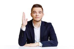 Portrait of handsome man in formalwear raising his hand