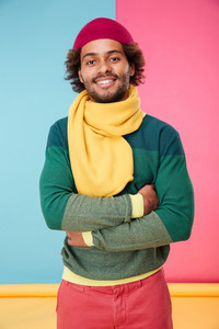 Portrait of happy african american young man in hat and scarf