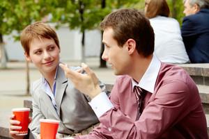 Portrait of happy business partners having break outside at summer