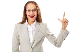 Portrait of happy businesswoman looking at camera with her forefinger raised