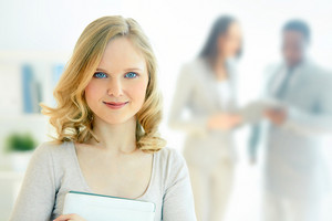 Portrait of happy businesswoman looking at camera with smile