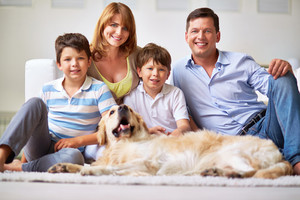 Portrait of happy family members and restful dog