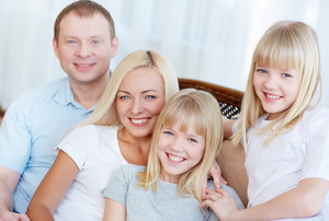 Portrait of happy family with two children smiling at camera