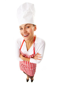 Portrait of happy female chef standing in isolation