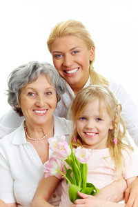 Portrait of happy female relatives looking at camera