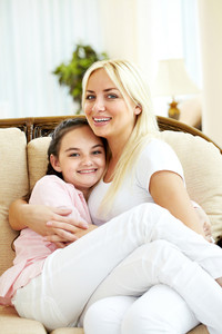 Portrait of happy mother and daughter embracing