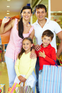 Portrait of happy parents and children during shopping