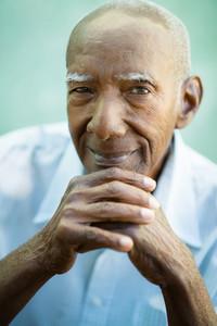 Portrait of happy senior hispanic man looking at camera and smiling