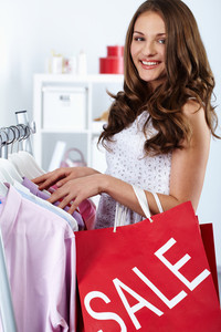 Portrait of happy woman with shopping bags at sales period