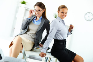 Portrait of happy young businesswomen posing in office