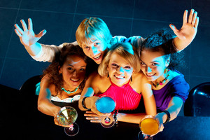 Portrait of happy young people toasting in the nightclub