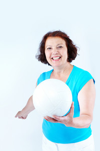 Portrait of healthy middle-aged female holding white leather ball
