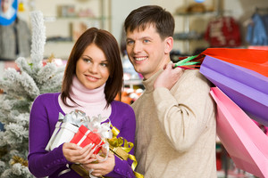 Portrait of husband and wife during shopping before Christmas