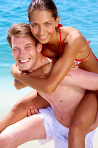 Portrait of joyful couple having fun in the water
