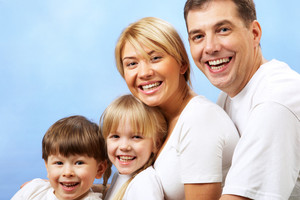Portrait of joyful family laughing
