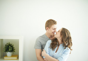 Portrait of joyful young couple standing face to face