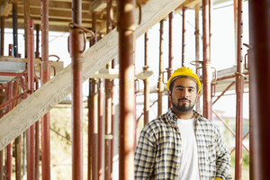 Portrait of latin american construction worker looking at camera
