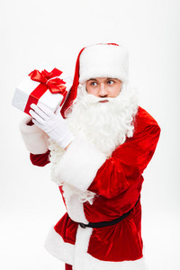 Portrait of man santa claus with gift box