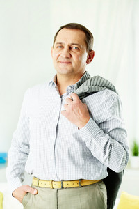 Portrait of mature man in casual looking at camera