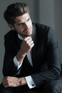 Portrait of model in suit. looking away