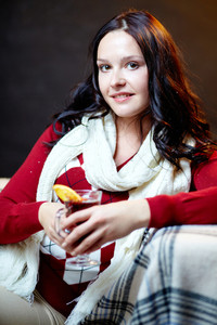 Portrait of pretty female with tea looking at camera