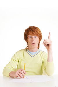 Portrait of redhead student pointing upwards and looking at camera