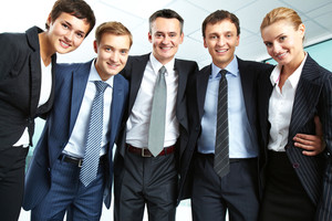 Portrait of successful business group looking at camera with smiles