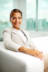 Portrait of successful female sitting in office