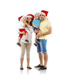 Portrait of the happy family with two children and pregnant mother in christmas hats, isolated on white background