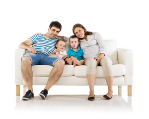 Portrait of the happy family with two children and pregnant mother sitting on sofa, isolated on white background