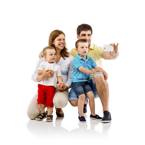Portrait of the happy family with two children and pregnant mother taking selfie, isolated on white background
