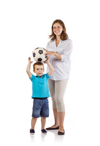 Portrait of the happy pregnant mother with her son playing with soccer ball