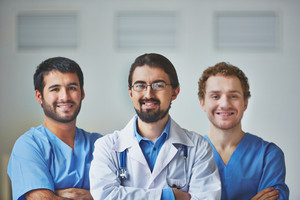 Portrait of three confident medical workers