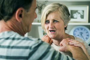 Portrait of woman victim of domestic violence. Man abusing senior woman with black eye-