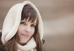 Portrait of woman with hood on in autumn country