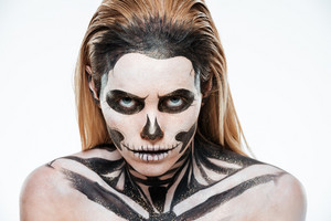 Portrait of woman with terrifying halloween makeup over white background