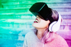 Portrait of young beautiful caucasian purple grey hair woman using 3D viewer - technology, futuristic, gaming concept