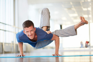 Portrait of young man doing physical exercise in gym