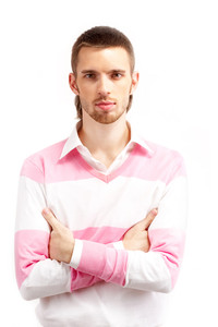 Portrait of young man looking at camera over white background