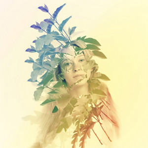 Portrait of young woman with abstract leaves