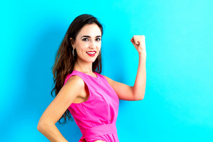 Powerful young woman on a blue background