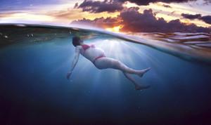Pregnant girl in a beautiful bikini underwater.
