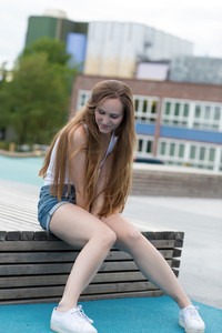 Pretty and smiling young woman in the city